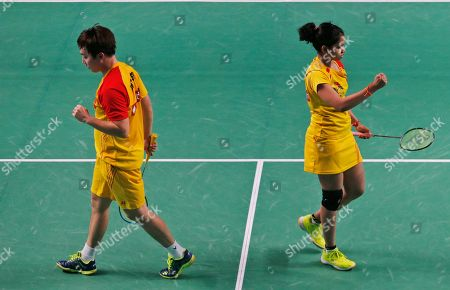 Korean badminton player Kim Sa Rang, left, and Indian badminton player Sikki Reddy of Bengaluru Blasters react after winning a point against Indian badminton player Ashwini Ponnappa and Russian badminton player Ivanov Vladimir of Delhi Dashers during the Premier Badminton League mixed doubles match in New Delhi, India, . Bengaluru Blasters won the match 15-10, 12-15, 15-11