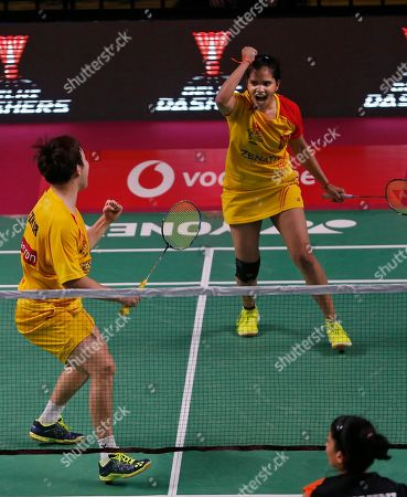 Korean badminton player Kim Sa Rang, left, and Indian badminton player Sikki Reddy of Bengaluru Blasters celebrate their win against Indian badminton player Ashwini Ponnappa and Russian badminton player Ivanov Vladimir of Delhi Dashers during the Premier Badminton League mixed doubles match in New Delhi, India, . Bengaluru Blasters won the match 15-10, 12-15, 15-11