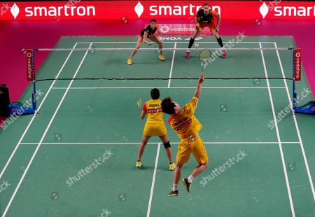 Korean badminton player Kim Sa Rang, foreground right, and Indian badminton player Sikki Reddy of Bengaluru Blasters, play against Indian badminton player Ashwini Ponnappa and Russian badminton player Ivanov Vladimir of Delhi Dashers during the Premier Badminton League mixed doubles match in New Delhi, India, . Bengaluru Blasters won the match 15-10, 12-15, 15-11