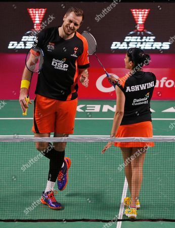 Indian badminton player Ashwini Ponnappa, right, pats her teammate and Russian badminton player Ivanov Vladimir of Delhi Dashers as they lost a point against Korean badminton player Kim Sa Rang and Indian badminton player Sikki Reddy of Bengaluru Blasters during the Premier Badminton League mixed doubles match in New Delhi, India, . Bengaluru Blasters won the match 15-10, 12-15, 15-11