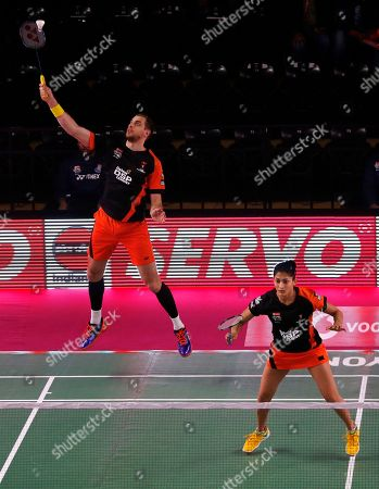 Russian badminton player Ivanov Vladimir, left, and Indian badminton player Ashwini Ponnappa of Delhi Dashers play against Korean badminton player Kim Sa Rang and Indian badminton player Sikki Reddy of Bengaluru Blasters during the Premier Badminton League mixed doubles match in New Delhi, India, . Bengaluru Blasters won the match 15-10, 12-15, 15-11