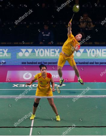 Korean badminton player Kim Sa Rang, right, and Indian badminton player Sikki Reddy of Bengaluru Blasters play against Indian badminton player Ashwini Ponnappa and Russian badminton player Ivanov Vladimir of Delhi Dashers during the Premier Badminton League mixed doubles match in New Delhi, India, . Bengaluru Blasters won the match 15-10, 12-15, 15-11
