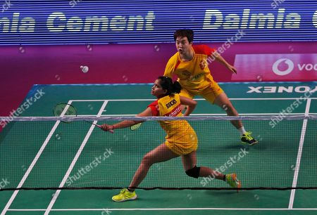 Indian badminton player Sikki Reddy, foreground, and Korean badminton player Kim Sa Rang of Bengaluru Blasters play against Indian badminton player Ashwini Ponnappa and Russian badminton player Ivanov Vladimir of Delhi Dashers during the Premier Badminton League mixed doubles match in New Delhi, India, . Bengaluru Blasters won the match 15-10, 12-15, 15-11