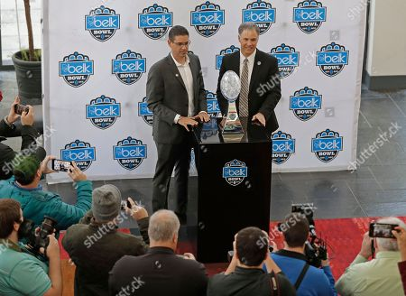 Dave Clawson, Jeff Banks. Wake Forest head coach Dave Clawson, right, and Texas A&M interim head coach Jeff Banks, left, pose with the trophy during media day for the Belk Bowl NCAA college football game in Charlotte, N.C