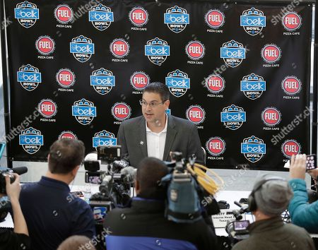 Texas A&M interim head coach Jeff Banks answers a question during media day for the Belk Bowl NCAA college football game in Charlotte, N.C