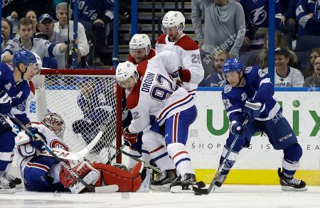 Carey Price, Jonathan Drouin, Brayden Point. Tampa Bay Lightning center Brayden Point (21) prepares to score past Montreal Canadiens goalie Carey Price (31) during the third period of an NHL hockey game, in Tampa, Fla. Montreal center Jonathan Drouin (92) looks on