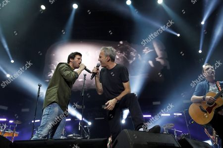 Stock Picture of Spanish band 'Hombres G' singer and bassist David Summers (2-R) and Spanish singer Willy Barcenas of 'Taburete' (L) perform during a concert held at WiZink Center in Madrid, Spain, 28 December 2017 (issued 29 December 2017). Spanish singer Willy Barcenas of 'Taburete' is well-kown for being the son of former treasurer of the People's Party (PP) Luis Barcenas who is curently on trial accused of bribery, money laundering and tax evasion on the Guertel corruption case.