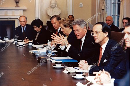 United States President Bill Clinton chairs a Cabinet Meeting in the Cabinet Room of the White House in Washington, DC. Pictured from Left to Right: Richard Riley, US Secretary of Education; Donna Shalala, US Secretary of Health and Human Services; Bruce Babbitt, US Secretary of the Interior; Madeleine Albright, US Secretary of State; President Clinton; Erskine Bowles, White House Chief of Staff; and William Cohen, Secretary of Defense In the background, from left to right: Gene B Sperling, Assistant to the President President for Economic Policy and Jack Gibbons, Director, Office of Science and Technology Policy