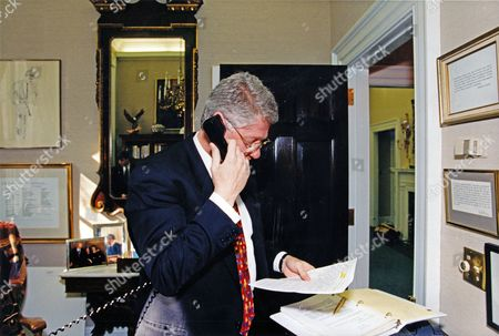 Upon reading a news account of American Olympic speed skater Dan Gold Medal win in the 1,000 meter race, United States President Bill Clinton calls Jansen in Lillehammer, Norway from his study in the White House in Washington, DC to offer his congratulations.