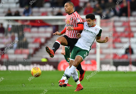 Barnsley's Zeki Fryers wins a tackle from Tyias Browning.