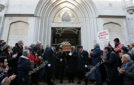 The coffin of late Italian chef Gualtiero Marchesi is carried outside Milan's Santa Maria del Suffragio church during his funeral, Italy, . Marchesi has been the first Italian chef to be awarded with three Michelin stars