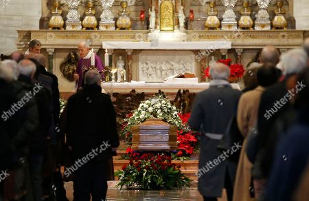 People attend the funeral of late Italian chef Gualtiero Marchesi in Milan's Santa Maria del Suffragio church, Italy, . Marchesi has been the first Italian chef to be awarded with three Michelin stars