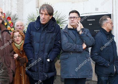Italian chef Davide Oldani, left, attends at the funeral of the Italian chef Gualtiero Marchesi outside Milan's Santa Maria del Suffragio church, Italy