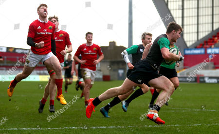 Munster Development vs Ireland U20's. Ireland's Peter Sullivan scores a try as Conor Hayes of Munster reacts