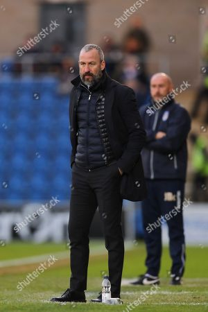 Manager of Cambridge United, Shaun Derry and Manager of Colchester United, John McGreal look on - Colchester United v Cambridge United, Sky Bet League Two, Weston Homes Community Stadium, Colchester - 1st January 2018.