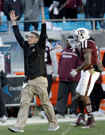 Texas A&M interim head coach Jeff Banks, left, reacts to an apparent touchdown against Wake Forest during the second half of the Belk Bowl NCAA college football game in Charlotte, N.C., . The player was ruled down before the goal line