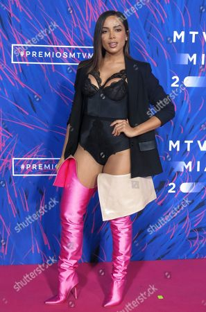 """File. In this photo, Brazilian singer Anitta arrives to the MTV MIAW awards in Mexico City. Anitta had a good year with hits such as """"Paradinha"""", """"Downtown"""" and """"Vai malandra"""" but she still remembers her origins as a favela girl and respects legends of Brazilian music such as Caetano Veloso and Gilberto Gil"""