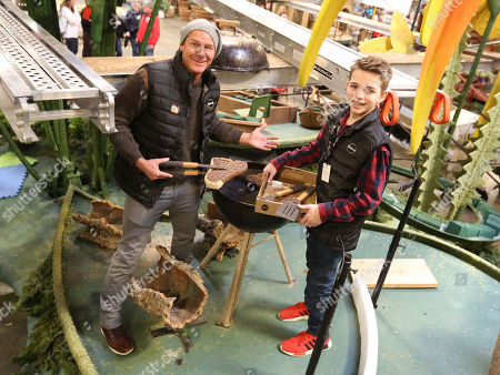 Ty Pennington, Ryker Cruze. TV personality Ty Pennington, left, and Miracle-Gro's float rider Ryker Cruze, right, help volunteers decorate the company's 2018 Rose Parade float at Fiesta Parade Floats on in Irwindale, Calif