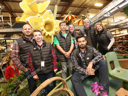 Tyler Cruze, Ryker Cruze, Olin Snakenborg, Shirley Barrett, Emmanuel Garcia, Ty Pennington, Mary Kimball. TV personality Ty Pennington, second from right, and Miracle-Gro's float riders, Tyler Cruze, from left, Ryker Cruze, Olin Snakenborg, Shirley Barrett, Emmanuel Garcia and Mary Kimball help kick Miracle-Gro's 2018 Rose Parade campaign at Fiesta Parade Floats on in Irwindale, Calif