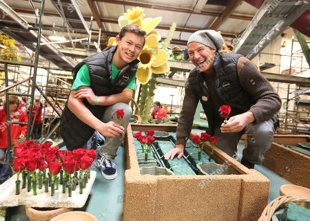 Olin Snakenborg, Ty Pennington. TV personality Ty Pennington, right, and Miracle-Gro's float rider Olin Snakenborg, left, help volunteers decorate the company's 2018 Rose Parade float at Fiesta Parade Floats on in Irwindale, Calif