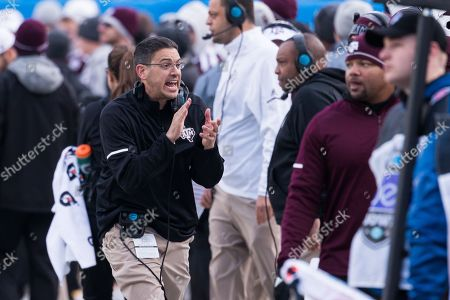 Texas A&M head coach Jeff Banks keeps his team excited in the matchup between Texas A&M and Wake Forest at Bank of America Stadium in Charlotte, NC