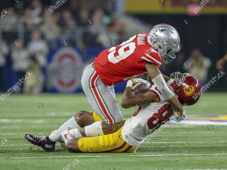 Ohio State Buckeyes cornerback Jeffrey Okudah tackles USC Trojans tight end Daniel Imatorbhebhe (88) after a reception in the first quarter during the Goodyear Cotton Bowl Classic between the USC Trojans and the Ohio State Buckeyes at AT&T Stadium in Arlington, TX