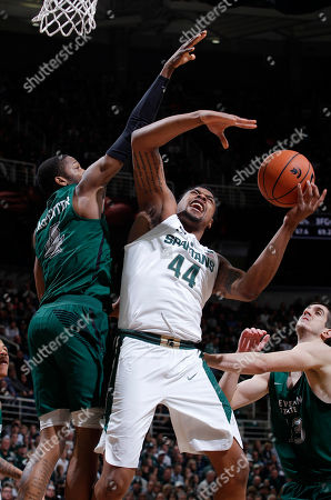 Nick Ward, Kenny Carpenter, Stefan Kenic. Michigan State's Nick Ward (44) draws a foul against Cleveland State's Kenny Carpenter, left, and Stefan Kenic, right, during the second half of an NCAA college basketball game, in East Lansing, Mich. Michigan State won 111-61