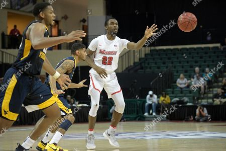 Austin Williams, James Bolden, Sagaba Konate. Marist guard Austin Williams (22) passes the ball in front of West Virginia guard James Bolden and forward Sagaba Konate, left, during the first half of an NCAA college basketball game at the AdvoCare Invitational tournament, in Lake Buena Vista, Fla