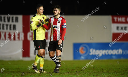 Christy Pym of Exeter City & Jordan Moore-Taylor of Exeter City after the game, during the Sky Bet League 2 match between Exeter City and Barnet, at St James Park, Exeter, Devon on December 30th,