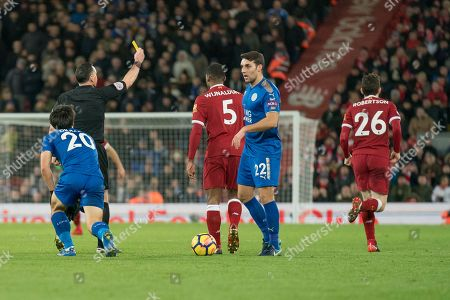 Liverpools Andy Robinson is shown a yellow card by referee Neil Swarbrick