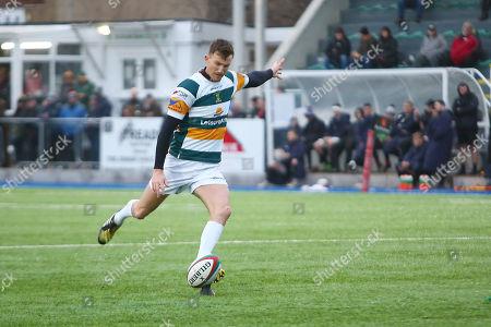 Matthew Jarvis of Merthyr kicks a goal