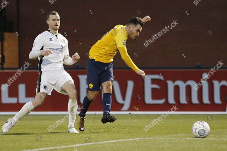Stock Image of Jake Gosling of Torquay United has a shot during the Vanarama National League match between Boreham Wood and Torquay United on December 30th 2017 at Meadow Park, Boreham Wood, Hertfordshire, England.