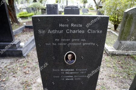 Stock Picture of The headstone at the grave of Sir Arthur Charles Clarke, with the inscription 'He never grew up, but he never stopped growing' at the General Cemetery at Borella in Colombo, Sri Lanka, 30 December 2017. Sir Arthur C. Clarke died in Colombo, Sri Lanka on 19 March 2008. He earned a world name through being the co-writer of the screenplay for the epic film 2001: A Space Odyssey in 1968. In 1961 he was awarded the Kalinga Prize, an award by the UNESCO for popularising science. He emigrated from England to Sri Lanka in 1956 due to his liking to scuba diving. He was knighted in 1998 and also awarded Sri Lanka?s highest civil honour, Sri Lanka bhimanya, in 2005. He was instrumental in establishing the Arthur C. Clarke Centre at the Moratuwa University of Sri Lanka in 1984, which was later renamed as the Arthur C. Clarke Institute for Modern Technologies (ACCIMT) and re-established as a corporate entity in 1994.