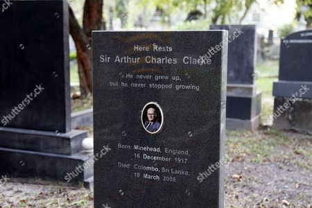 The headstone at the grave of Sir Arthur Charles Clarke, with the inscription 'He never grew up, but he never stopped growing' at the General Cemetery at Borella in Colombo, 30 December 2017. Born in Minehead, England on 16 December 1917, British science, science fiction writer, futurist, inventor, undersea explorer and television series host Sir Arthur C. Clarke died in Colombo on 19 March 2008. He emigrated from Britain to Sri Lanka in 1956, reportedly due to his liking of scuba diving.