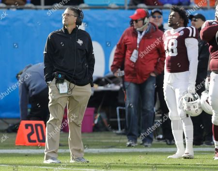 Texas A&M interim head coach Jeff Banks, left, watches a replay during the first half of the Belk Bowl NCAA college football game against Wake Forest in Charlotte, N.C