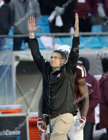 Texas A&M interim head coach Jeff Banks celebrates a touchdown against Wake Forest during the second half of the Belk Bowl NCAA college football game in Charlotte, N.C