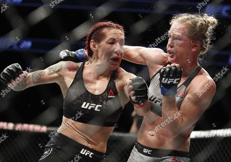 Holly Holm, right, fights Cris Cyborg during a featherweight championship mixed martial arts bout at UFC 219, in Las Vegas