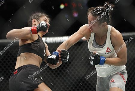Cynthia Calvillo, left, fights Carla Esparza in a strawweight mixed martial arts bout at UFC 219, in Las Vegas