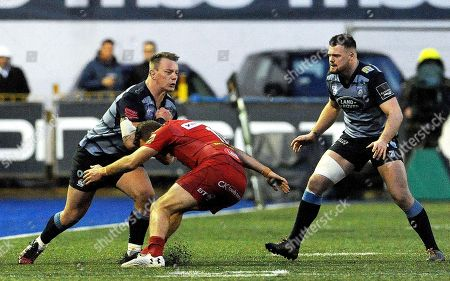 Cardiff Blues vs Scarlets. Cardiff Blues Matthew Rees with Scarlets Paul Asquith