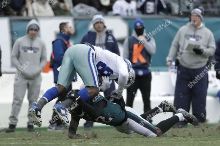Dez Bryant, Rasul Douglas. Dallas Cowboys' Dez Bryant, top, is tackled by Philadelphia Eagles' Rasul Douglas during the first half of an NFL football game, in Philadelphia