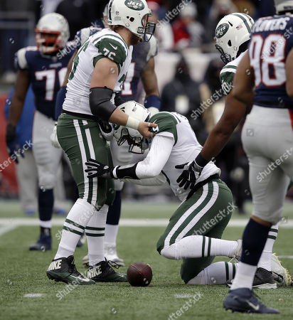 Wesley Johnson, Bryce Petty. New York Jets center Wesley Johnson, left, helps up quarterback Bryce Petty during the first half of an NFL football game against the New England Patriots, in Foxborough, Mass
