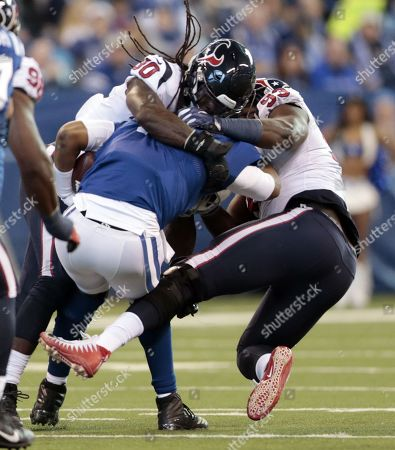 Indianapolis Colts quarterback Jacoby Brissett (7) is sacked by Houston Texans' Jadeveon Clowney (90) and Joel Heath (93) during the first half of an NFL football game, in Indianapolis