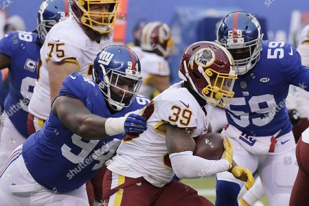 Dalvin Tomlinson, Keith Marshall. New York Giants' Dalvin Tomlinson (94) tackles Washington Redskins' Keith Marshall (39) during the second half of an NFL football game, in East Rutherford, N.J