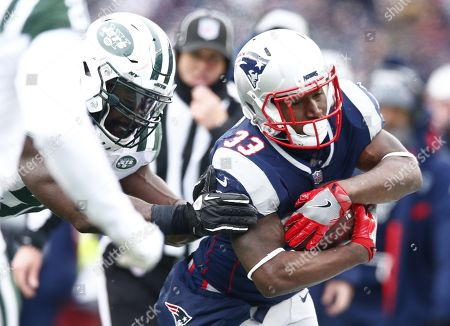 New York Jets defensive end Muhammad Wilkerson (L) knocks New England Patriots running back Dion Lewis (R) out of bounds during the second quarter at Gillette Stadium in Foxboro, Massachusetts, USA 31 December 2017.