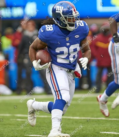 East Rutherford, New Jersey, U.S. - New York Giants running back Paul Perkins (28) with the ball in the first half during NFL action between the Washington Redskins and the New York Giants at MetLife Stadium in East Rutherford, New Jersey