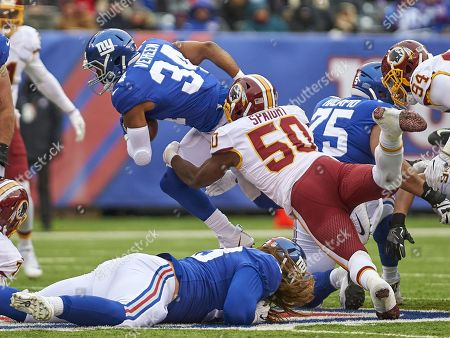 East Rutherford, New Jersey, U.S. - Washington Redskins inside linebacker Martrell Spaight (50) tackles New York Giants running back Shane Vereen (34) in the first half during NFL action between the Washington Redskins and the New York Giants at MetLife Stadium in East Rutherford, New Jersey. Giants defeated the Redskins 18-10