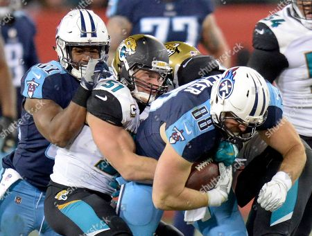 Jace Amaro, Paul Posluszny. Tennessee Titans tight end Jace Amaro (88) tries to break free from Jacksonville Jaguars middle linebacker Paul Posluszny (51) in the second half of an NFL football game, in Nashville, Tenn
