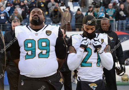 Marcell Dareus, A J Bouye. Jacksonville Jaguars defensive tackle Marcell Dareus (99) and cornerback A.J. Bouye (21) stand for the national anthem before an NFL football game against the Tennessee Titans, in Nashville, Tenn