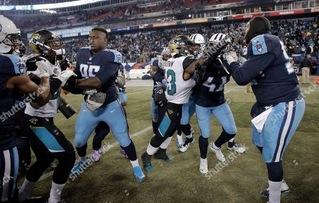 Donald Payne, Blair Brown, Jurrell Casey. Jacksonville Jaguars linebacker Donald Payne, second from left, and linebacker Blair Brown (53) fight with Tennessee Titans defensive end Jurrell Casey, right, after the Titans beat the Jaguars 15-10 in an NFL football game, in Nashville, Tenn