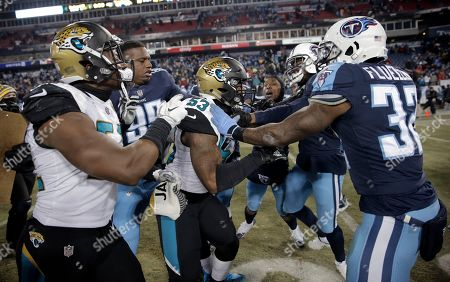 Blair Brown, David Fluellen, Angelo Blackson. Tennessee Titans defensive end Angelo Blackson (95) and running back David Fluellen (32) try to restrain Jacksonville Jaguars linebacker Blair Brown (53) during a scuffle after an NFL football game, in Nashville, Tenn. The Titans won 15-10